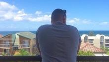 Man on balcony at beach